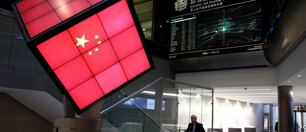 An illuminated cube bearing the Chinese flag is seen in the entrance foyer of the London Stock Exchange in London