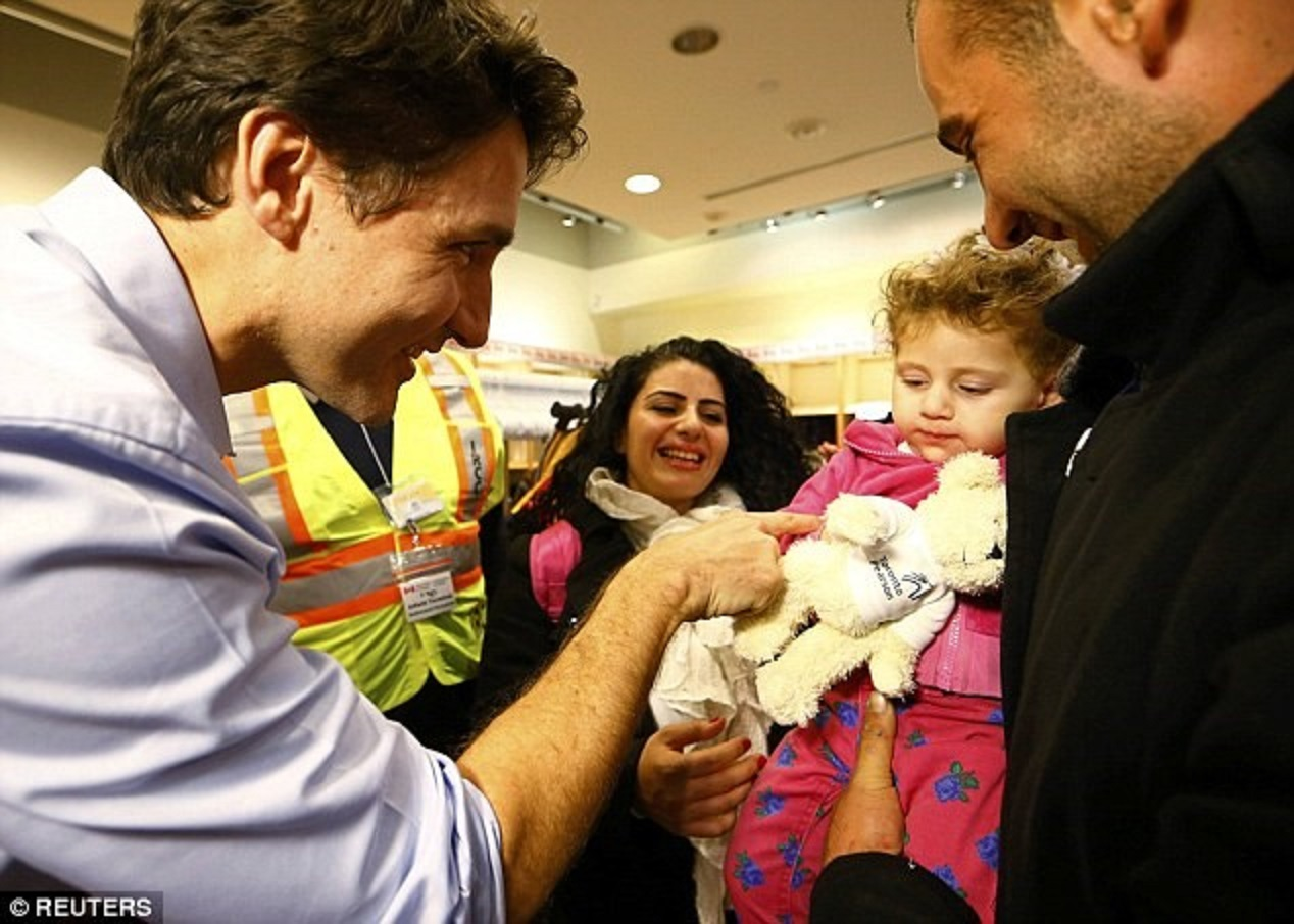 Image result for justin trudeau syrian refugees